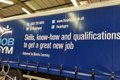 The Job Gym Trailer Signs